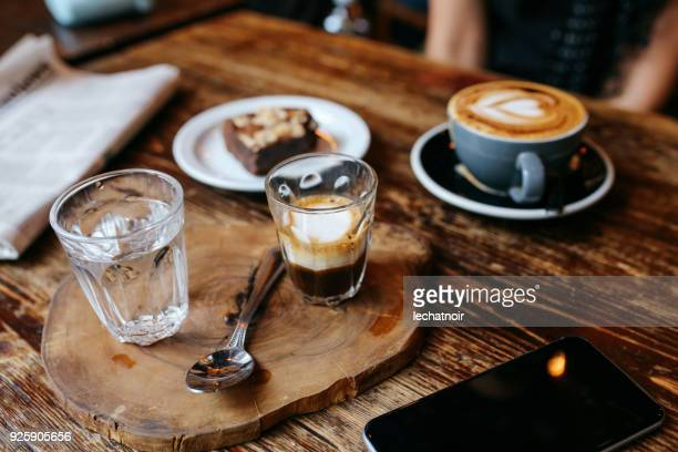 high angle view of coffee and cake on the table in a cafe in london downtown - ornate stock pictures, royalty-free photos & images