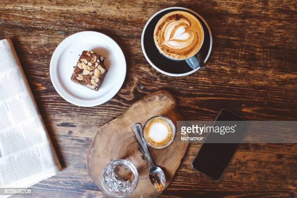 high angle view of coffee and cake on the table in a cafe in london downtown - brownie stock pictures, royalty-free photos & images