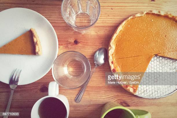High Angle View Of Coffee And Cakes On Table