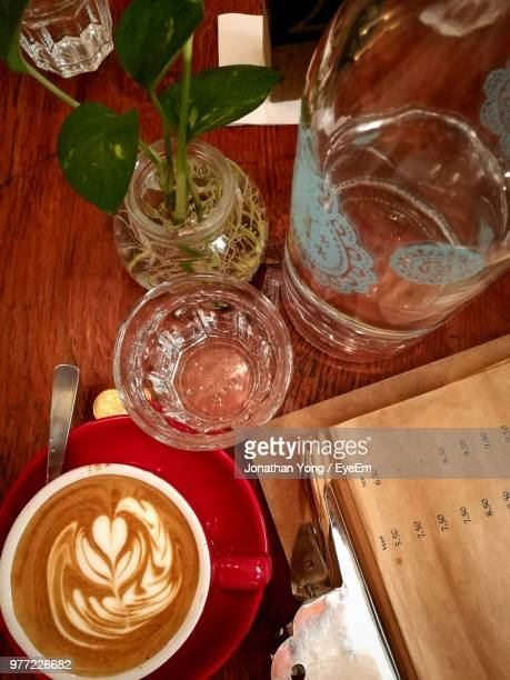 high angle view of coffee and drink on table - coffee drink stock pictures, royalty-free photos & images