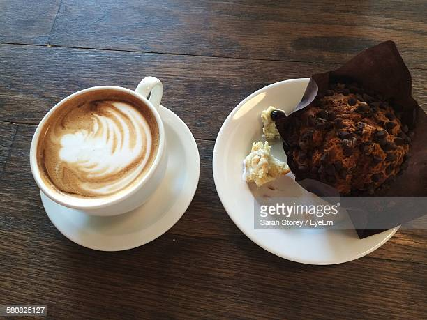 High Angle View Of Coffee And Muffin On Table At Home