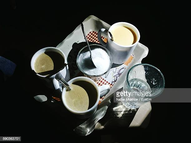 high angle view of coffee and tea with sugar on tray - nazar stock photos and pictures
