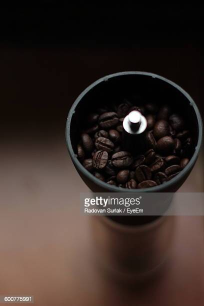 High Angle View Of Coffee Beans On Grinder