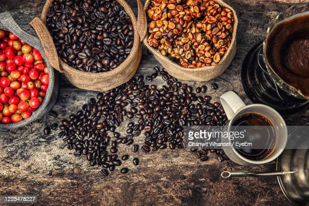 high angle view of coffee beans on table - civet cat stock pictures, royalty-free photos & images