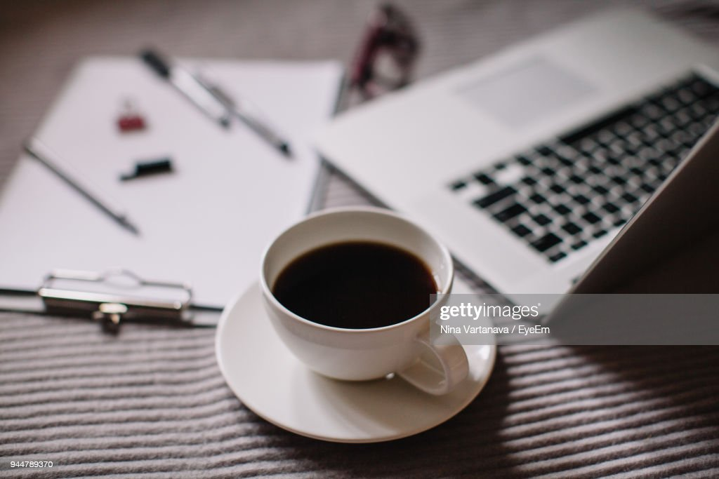 High Angle View Of Coffee By Laptop On Table : Stock Photo
