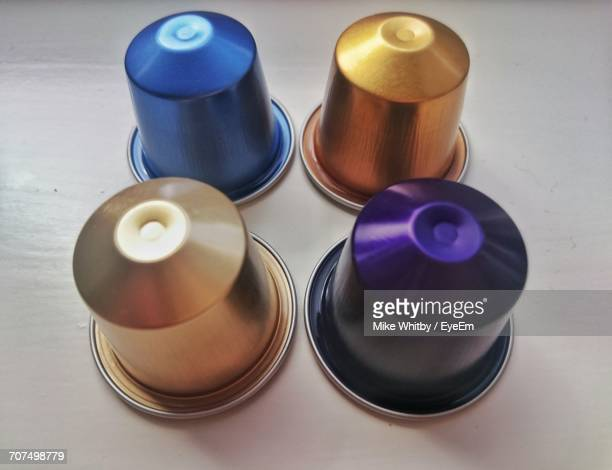 High Angle View Of Coffee Capsules On Table