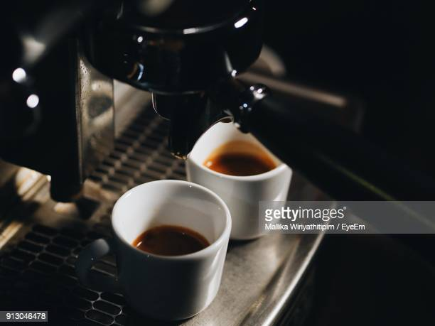 High Angle View Of Coffee Cup And Espresso Maker