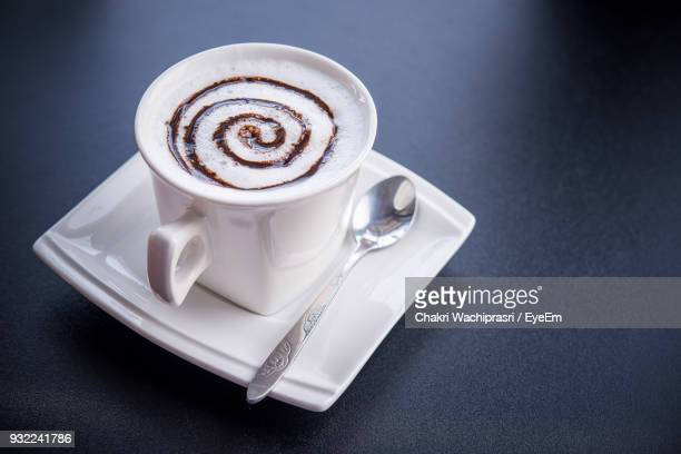 High Angle View Of Coffee Cup On Black Background
