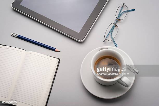 High Angle View Of Coffee Cup On Desk At Office