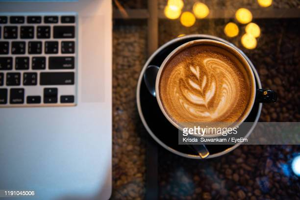 high angle view of coffee cup on table - provincia di songkhla foto e immagini stock