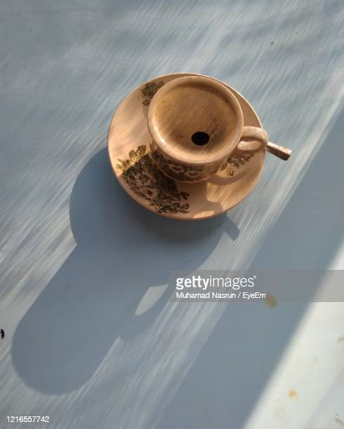 high angle view of coffee cup on table - muhamad nasrun stock pictures, royalty-free photos & images