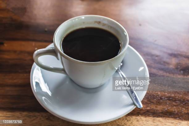 high angle view of coffee cup on table - civet cat stock pictures, royalty-free photos & images