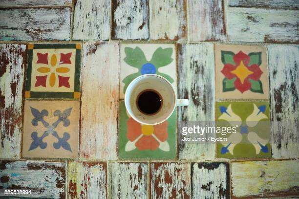 high angle view of coffee cup on table - mosaic stock photos and pictures