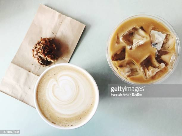 high angle view of coffee cup on table - iced coffee stock pictures, royalty-free photos & images