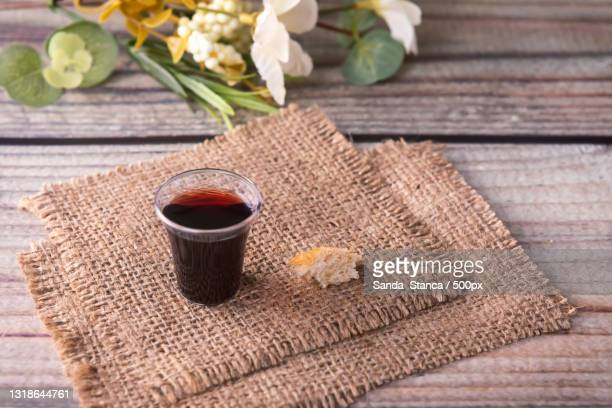 high angle view of coffee cup with burlap on table - good friday stock pictures, royalty-free photos & images