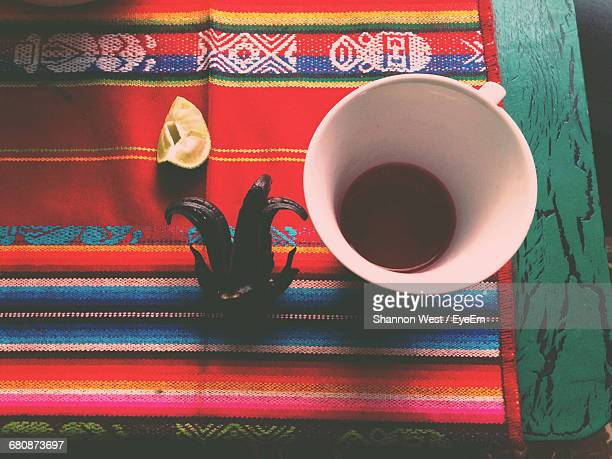 High Angle View Of Coffee Cup With Food On Tablecloth