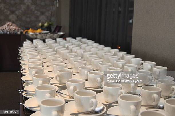 High Angle View Of Coffee Cups On Table