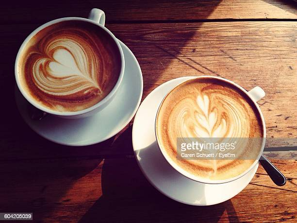 High Angle View Of Coffee Cups On Wooden Table