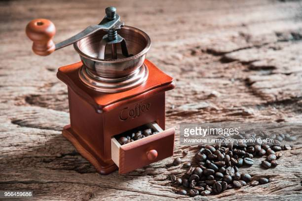 high angle view of coffee grinder on table - coffee grinder stock photos and pictures