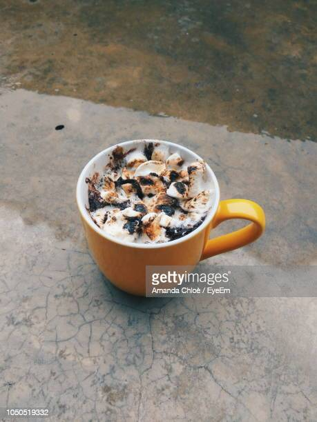 High Angle View Of Coffee In Cup On Footpath