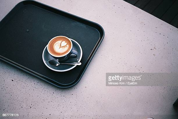 high angle view of coffee in serving tray on table - serving tray stock pictures, royalty-free photos & images