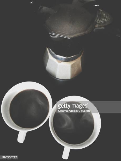 High Angle View Of Coffee Maker And Drink On Black Background