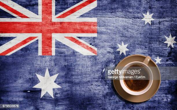 high angle view of coffee on australian flag painted wooden table - australian flag stock pictures, royalty-free photos & images
