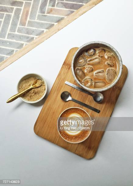 High Angle View Of Coffee On Cutting Board At Table