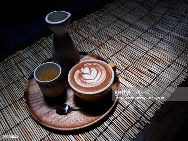High Angle View Of Coffee On Placemat