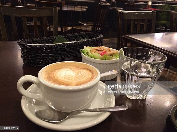 High Angle View Of Coffee On Table At Restaurant