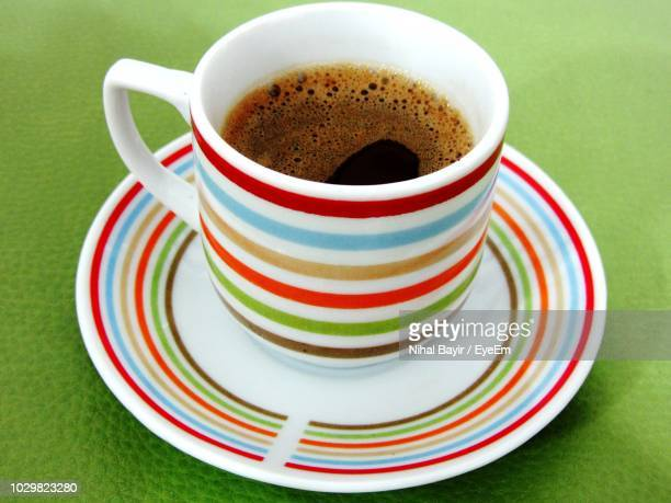 high angle view of coffee on table - saucer stock pictures, royalty-free photos & images