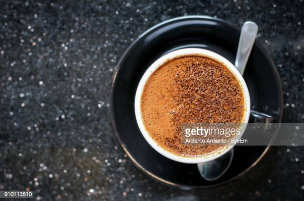 high angle view of coffee on table - ground coffee stock photos and pictures