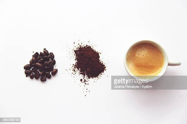 high angle view of coffee on white background - café moulu photos et images de collection