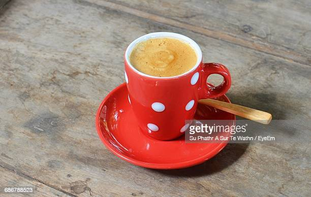 high angle view of coffee on wooden table at home - lunares fotografías e imágenes de stock