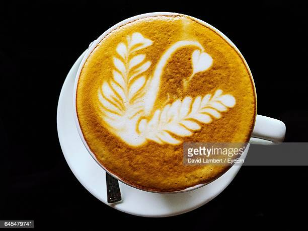 High Angle View Of Coffee Over Black Background