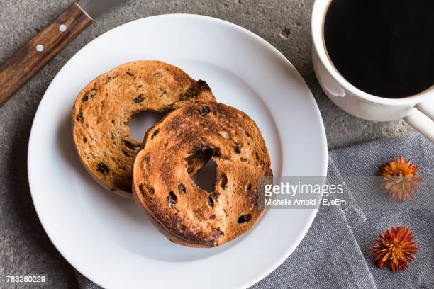 high angle view of coffee served on table - bagels stock pictures, royalty-free photos & images