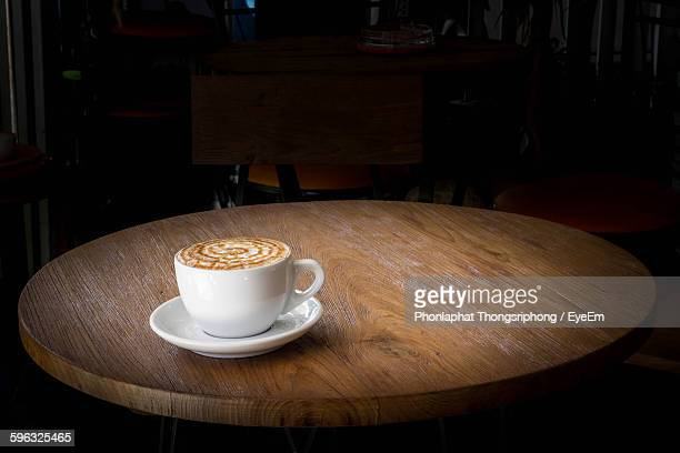 High Angle View Of Coffee Served On Wooden Table At Restaurant