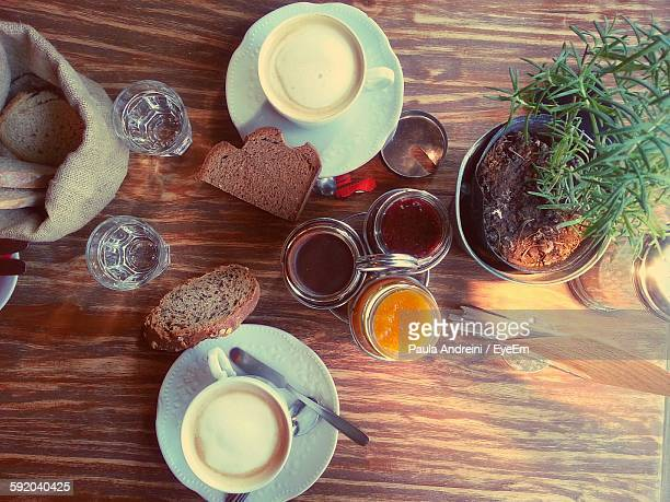 High Angle View Of Coffee With Bread And Preserves Served On Table