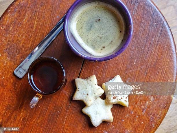 High Angle View Of Coffee With Cookies On Table
