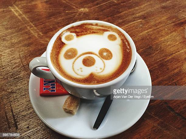 High Angle View Of Coffee With Latte Art Of Bear