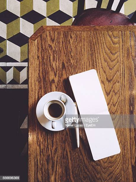 High Angle View Of Coffee With Pen And Note Pad