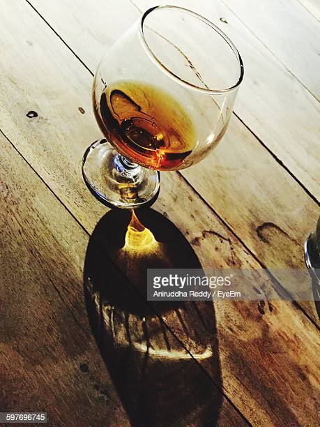 High Angle View Of Cognac Brandy In Wineglass On Table