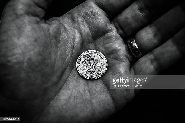 High Angle View Of Coin On Palm
