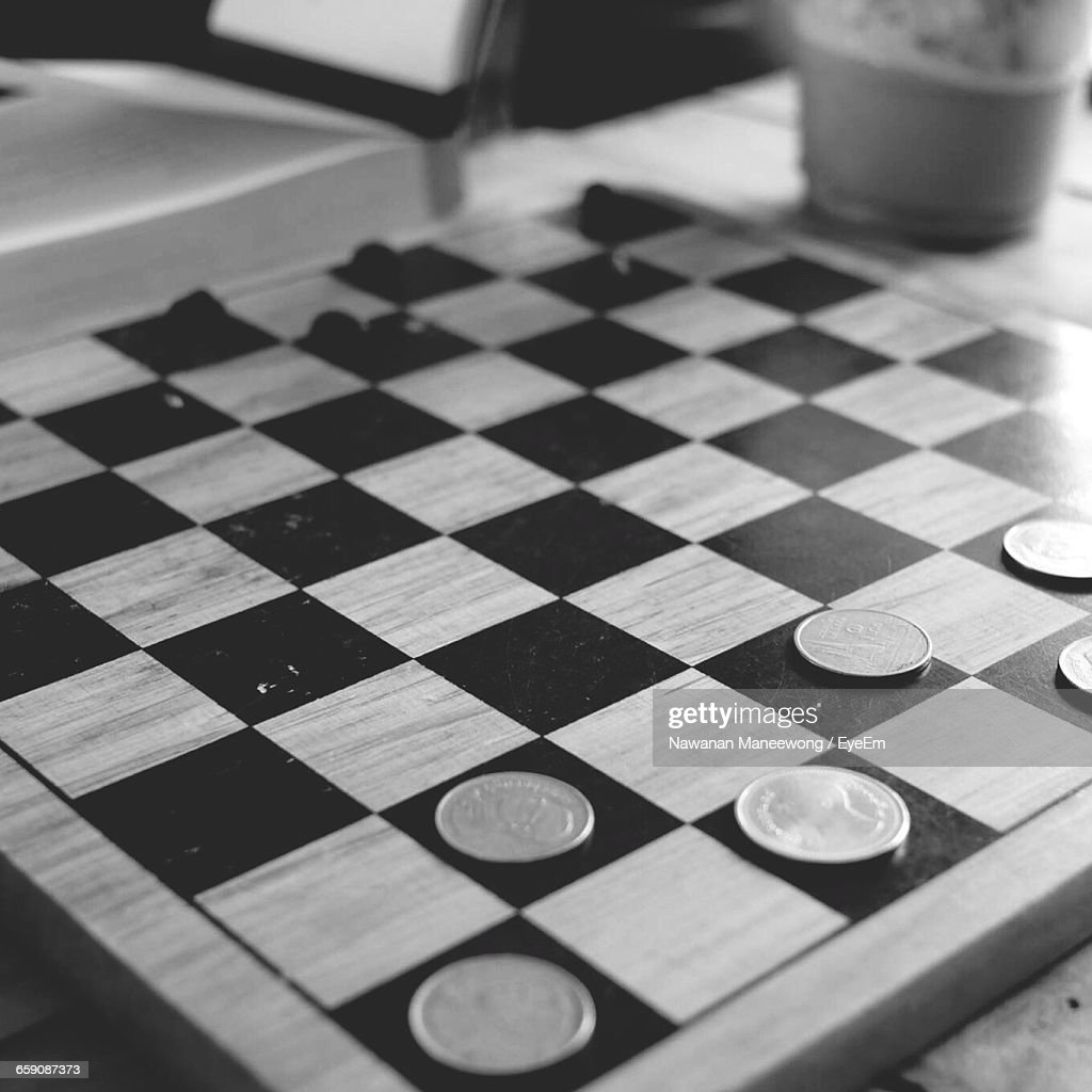 High Angle View Of Coins Arranged On Chess Board Stock Photo Getty