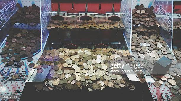 High Angle View Of Coins In Machine