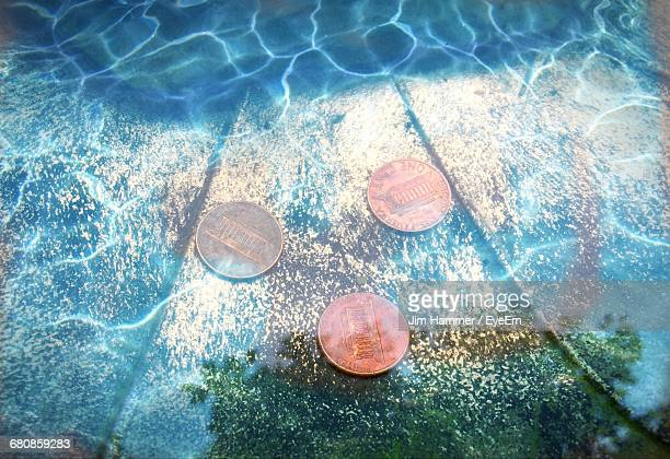 high angle view of coins in water - fountain stock pictures, royalty-free photos & images