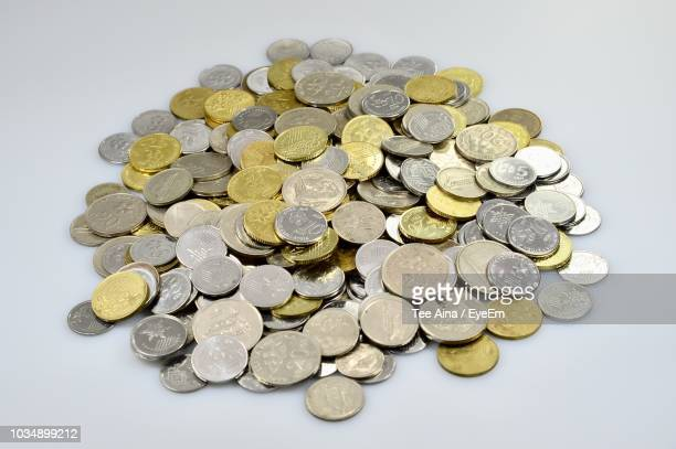 High Angle View Of Coins Over White Background