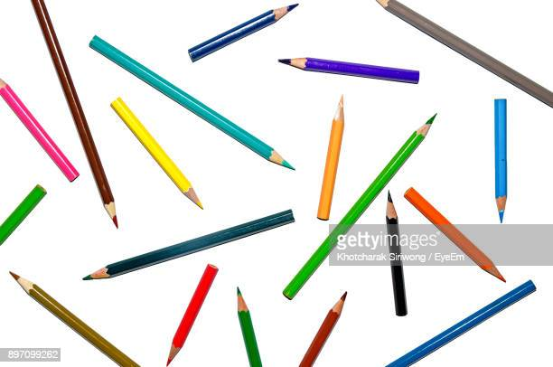 high angle view of colored pencils against white background - color pencil stock pictures, royalty-free photos & images