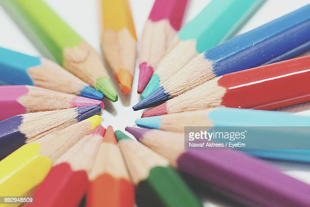 high angle view of colored pencils arranged on table - color pencil stock pictures, royalty-free photos & images