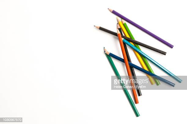 high angle view of colored pencils on white background - color pencil stock pictures, royalty-free photos & images